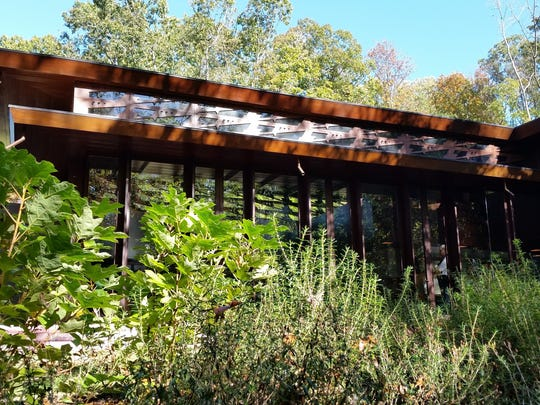 This Oct. 22, 2016 photo shows the rear of the Frank Lloyd Wright-designed Bachman-Wilson House which faces a wooded area at the Crystal Bridges Museum of American Art in Bentonville, Ark.