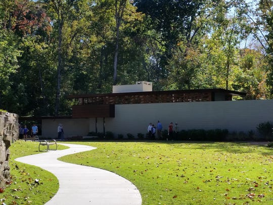 This Oct. 22, 2016 photo shows a cinder block wall marking the division between a family's public space and private space and is a dominant feature of the Frank Lloyd Wright-designed Bachman-Wilson House in Bentonville, Ark. Even the front door of the home doesn't face the street. The Crystal Bridges Museum of American Art moved the home from Millstone, N.J., to Bentonville and opened it to the public in 2015.