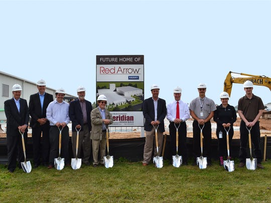 Red Arrow Products has broken ground on a 100,000-square-foot Global Center of Excellence for Smoke and Grill Technology on the former Foster Needle Company site. Pictured, from left, are: Daryl Adel, business unit president, Meat Systems & Flavors; Mark Crass, general manager/vice president; Justin Plutz, director of manufacturing; Robert Suennen, president/architect, OTA; Howard Baskin, director of Facilities & the Workplace; Ray Callahan, vice president of operations; Justin Nickels, Manitowoc mayor; Andrew Shavlik, plant manager; Lauren Hurley, production manager; and Jeff Keehan, process engineer.