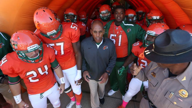 FAMU Head Coach Alex Wood leads his team out on to the field during their game against Hampton on Homecoming Saturday at Bragg Memorial Stadium.