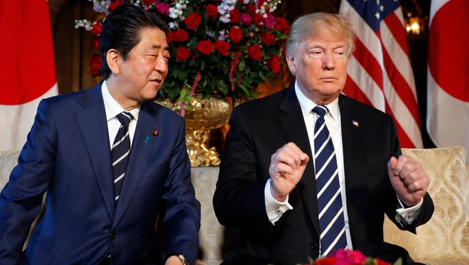 President Trump and Japanese Prime Minister Shinzo Abe speak during a meeting at Trump's private Mar-a-Lago club April 17, 2018, in Palm Beach, Fla.