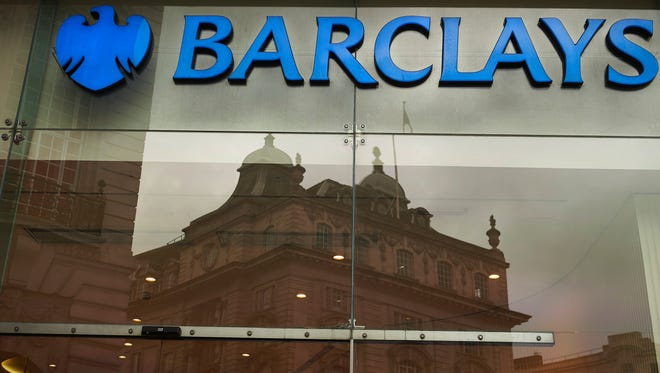 File photo taken in 2015 shows a logo of the British bank Barclays on a sign outside a bank branch of the bank in London.