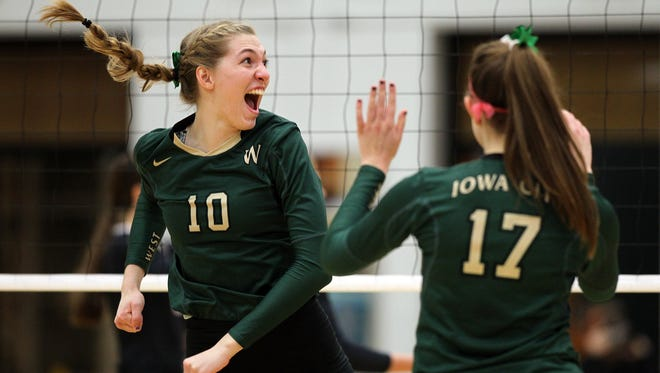 West High's Ali Tauchen celebrates a point during the Women of Troy's regional semifinal game against City High at West High on Thursday, Oct. 29, 2015.