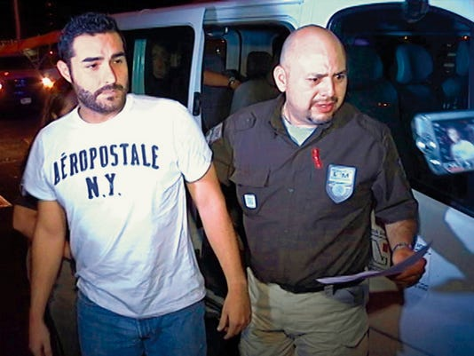 Henry Solis, 27,  was handed over to U.S. authorities Tuesday in the middle of the Stanton Street  Bridge.
