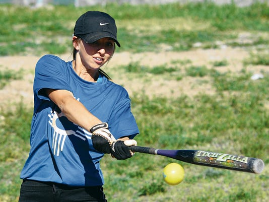 Matt Hollinshead — Current-Argus Carlsbad senior centerfielder Shelby Welch makes contact during batting practice Tuesday, March 24. Welch will continue her softball career at Lubbock Christian University.