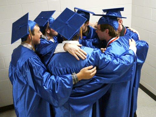Waynesboro Area Senior High School seniors huddle together prior to commencement Friday.