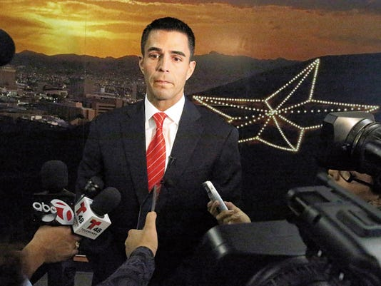 Matthew McElroy, director of international bridges, talks to the media outside City Council chambers Tuesday.