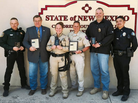 Three local officers were honored by Lincoln County social workers. From left — Deputy Jason Green, Lincoln County Sheriff's Office; Undersheriff Ken Cramer,LCSO; Officer Carolee Jones, Ruidoso Downs Police Department; Chief Chris Rupp, RDPD; Sargent Ray Merritt, Ruidoso Police Department; and Interim Lieutenant Lawrence Chavez, RPD.
