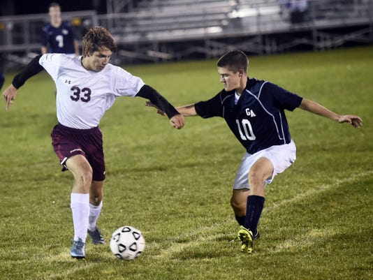 Shippensburg's Cole Souders (33) rushes to defend Luke Herman (10) of Greencastle during boy's soccer on Thursday. Greencastle never trailed in a 5-1 win over the Greyhounds.