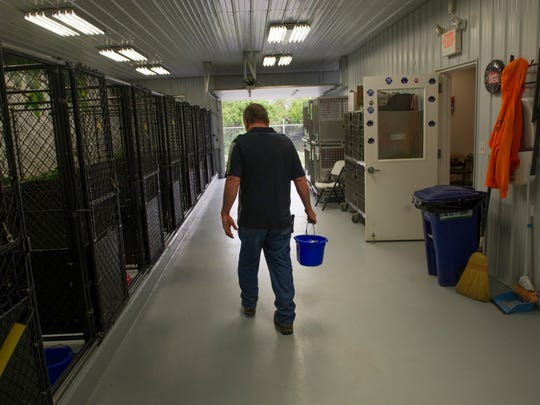 "Dog Warden Richie Jones hauls water at the Union County Dog Pound Tuesday afternoon. ÒRight now we donÕt have but six dogs,"" Jones said. ""We can have six today and 15 tomorrow.Ó"