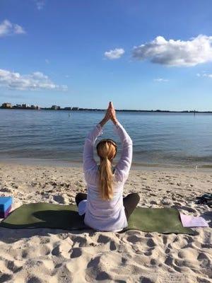 Yoga instructor Sheryl Purnell performs a yoga stretch.