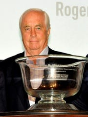 Roger Penske with the Cameron R. Argetsinger Award he received at the Corning Museum of Glass.