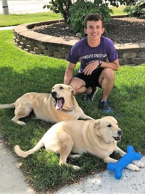 Plymouth resident Seth Windle developed a unique friendship with a pair of Canton dogs.