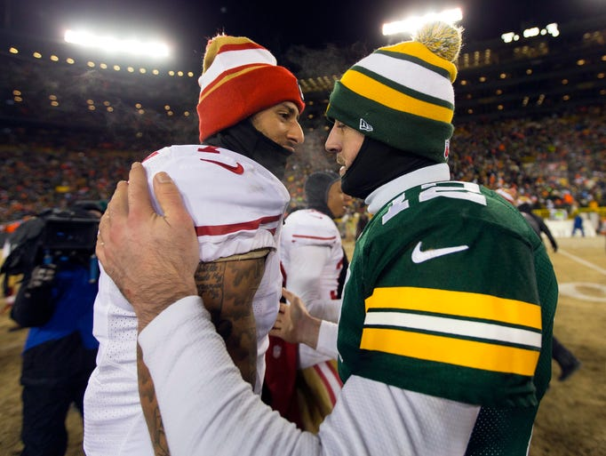 San Francisco 49ers quarterback Colin Kaepernick (7) greets Green Bay Packers quarterback Aaron Rodgers (12) following the 2013 NFC wild card playoff football game at Lambeau Field.  San Francisco won 23-20.