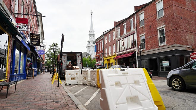 Outdoor dining barriers have been added outside of Cup of Joe on Market Street in Portsmouth. Efforts to provide more dining space are not nearly enough to save dowtown businesses from damage brought by the coronavirus pandemic, members of a city task force have been told.