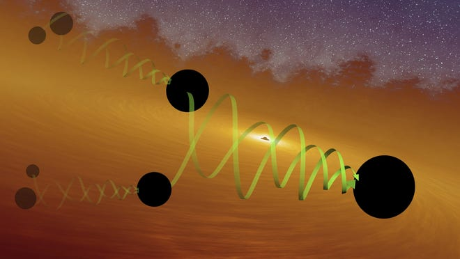 This illustration provided by LIGO/Caltech in September 2020 depicts two black holes of about 66 and 85 solar masses spiralling into each other to form the GW190521 black hole. Gravitational waves from the merger were detected by the LIGO and Virgo observatories in May 2019.