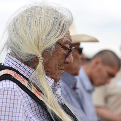 Northern Arapaho elder Mark Soldier Wolf stands with