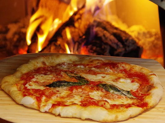 At Pizzeria Bocce, pizzas are hand-stretched, topped