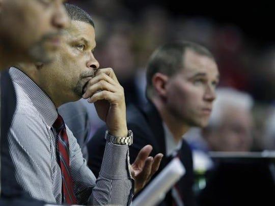 Rutgers head coach Eddie Jordan, center, saw a lot of losses in three years.