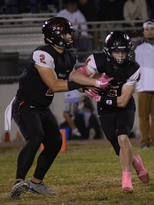 Rio Mesa quarterback Austin Maciel, left, fakes a handoff to Dylan Rusch during the Spartans' 41-35 win Friday night. Rusch ran for 160 yards and two touchdowns and caught five passes for 77 yards, including a 10-yard score.