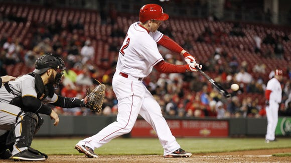Cincinnati Reds third baseman Todd Frazier (21) hits a two-run home run in the sixth inning against the Pittsburgh Pirates.