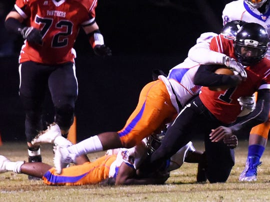 Parkway's Justin Rogers cannot get past Landry-Walker's defense in the 5A playoff football game Friday evening at Parkway's Preston Crownover.