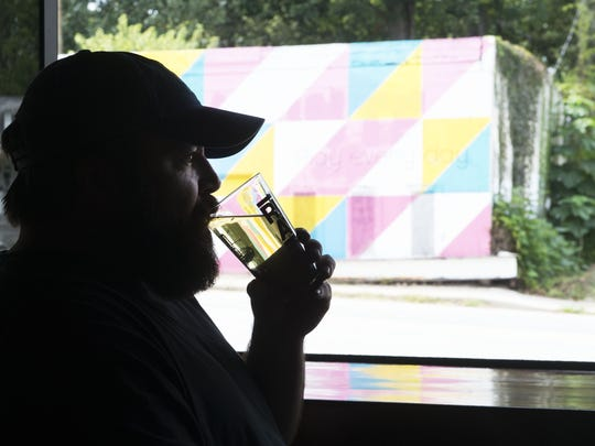 Production director and cider maker Gregory Hill tastes fresh cider at Urban Orchard Cider Co.