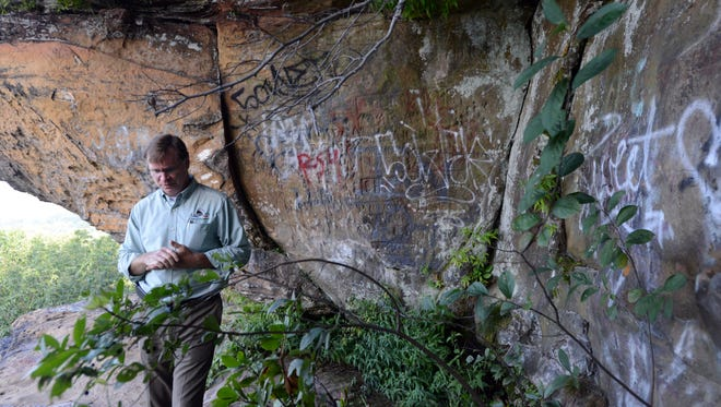 Lancaster Parks and Recreation Superintendent Mike Tharp walks next to a wall of graffiti on the face of Mount Pleasant Wednesday, Sept. 6, 2017, in Lancaster.