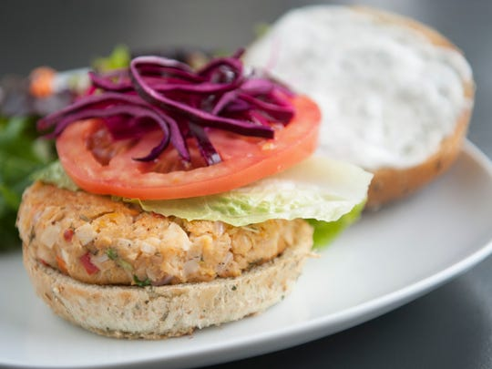 Patty (a vegan-style 'crab cake' patty is made from hearts of palm, chickpeas, fresh herbs and veggies, topped with lettuce, tomato and pickled cabbage with a lemon dill aioli served on a sprouted grain bun with a side salad at Leaf vegan eatery in Haddonfield.