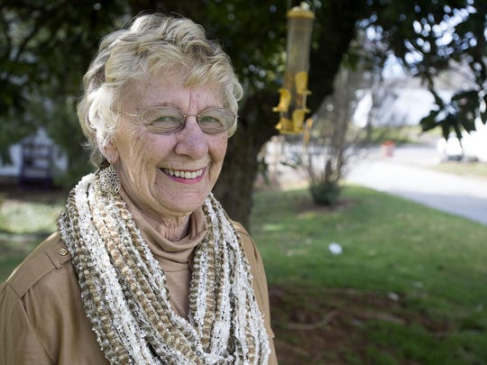 Longtime columnist and writer Edie Burnette stands
