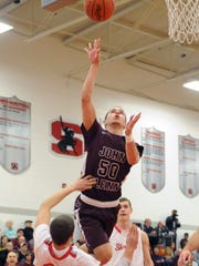 John Glenn's Drew Rackley goes up for a shot during a regular season game at Sheridan. The 6-1 junior, who led the Muskies in scoring, was named first-team All-Ohio on Monday.