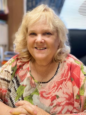 Marie Senften-Deitz, executive director of the Canton Calvary Mission, is retiring after 14 years.
