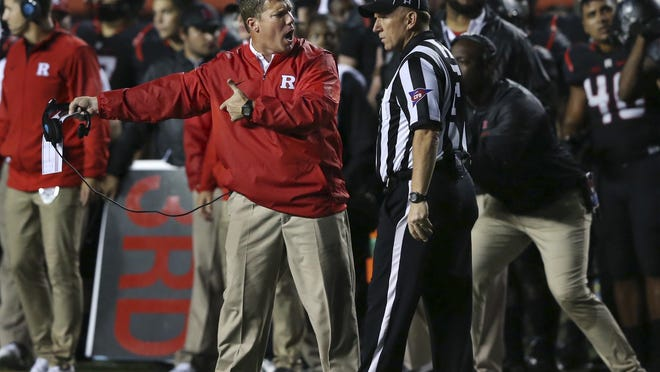 Rutgers head coach Chris Ash complains about a call to field judge John Roggeman during the first half of the Michigan game Saturday in Piscataway.