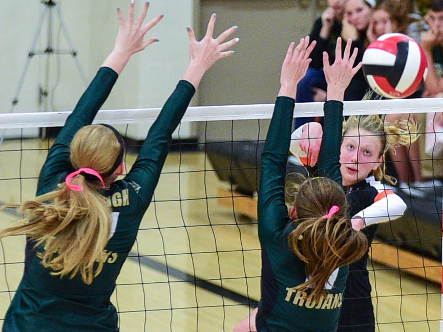 West Des Moines Valley's Hannah Lockin (6) meets a wall of arms from Iowa City West's defense at the Class 5A-Region 5 regional finals held at Newton High School on Tuesday, Nov. 4, 2014.