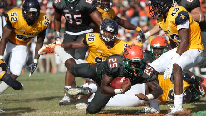 FAMU's Devin Bowers dives in to the endzone for a touchdown against N.C. A&T at Bragg Memorial Stadium Saturday, Oct. 14, 2017.