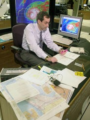 National Hurricane Center spokesman Ed Rappaport studies