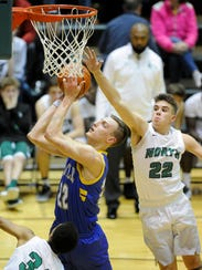 Castle's Jack Nunge (22) goes to the hoop against North's
