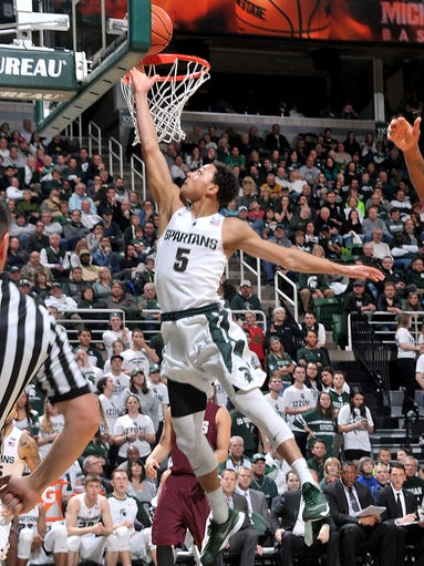 Michigan State's Bryn Forbes drives to the basket and