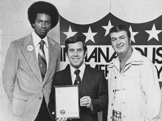 """Indinaapolis Mayor Richard Lugar (center) holds a proclamation setting aside Oct 2, 1975 as """"Pacer Proud Day"""".  With him are Darnell Hillman (left) and coach Bobby Leonard.  Indinaapolis Star file photo"""