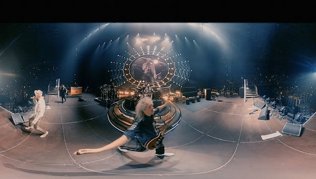 """Queen + Adam Lambert, who just performed at the Hollywood Bowl, are releasing their first-ever live-concert VR experience, """"VR THE CHAMPIONS,"""" in full 360 degree 3-D, through VRTGO, Universal Music Group's VR platform, for $9.99."""