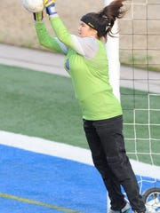 Cooper goalie Brandy Hagood makes a stop on a Lubbock