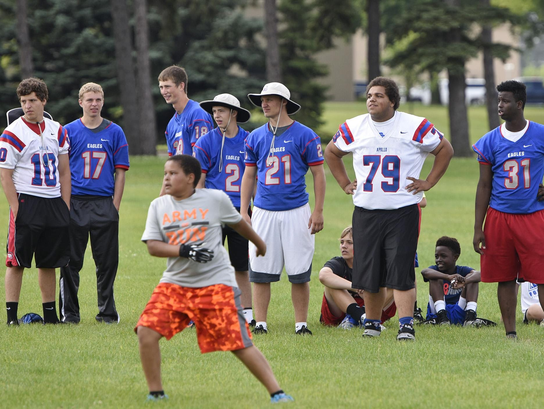 Apollo players watch youth camp participants compete Friday at the high school in St. Cloud.
