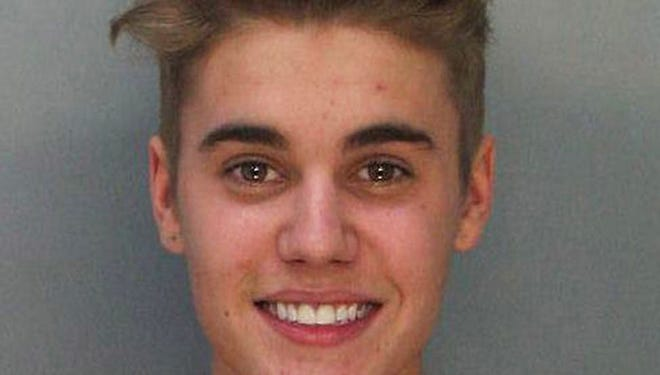 This handout photograph provided by the Miami-Dade Police Department shows pop star Justin Bieber posing for a booking photo on Jan. 23.