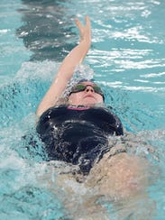 Franklin's Paige Rivait competes in the 100-yard backstroke.