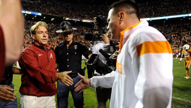 Alabama coach Nick Saban shakes hands with Tennessee coach Butch Jones after their game Saturday, Oct. 25, 2014, at Neyland Stadium. Alabama won 34-20.