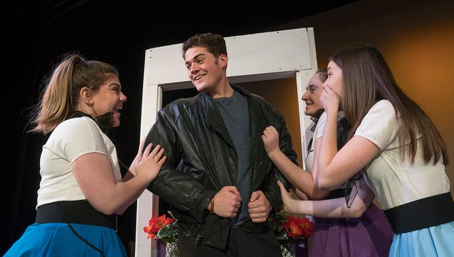 Conrad Birdie (Carson Peasley) greets his fans. Margie (Maggie Kalt), Deborah Sue (Rose Sher), and Nancy (Ashley Buechner) are a little excited.