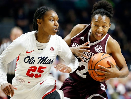 Mississippi guard Alissa Alston (25) fouls Mississippi State guard Morgan William (2) during the first half of an NCAA college basketball game in Oxford, Miss., Sunday, Jan. 28, 2018. (AP Photo/Rogelio V. Solis)