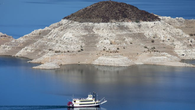 """A """"bathtub ring"""" on Lake Mead in late 2014 shows how far the water level has fallen."""