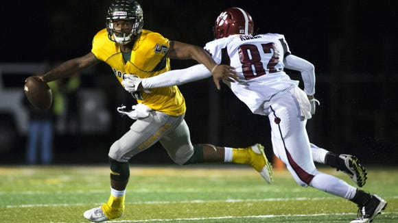 Reynolds senior Rico Dowdle, left, has committed to play college football for South Carolina.