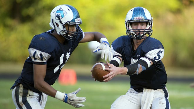 Asheville School senior David Schill, right, has committed to play college football for Centre (Ky.).